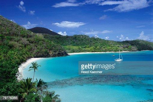 Sailboat Anchored in Tropical Bay