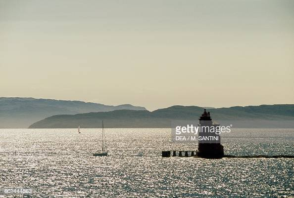 A sailboat and a lighthouse near Trondheim SorTrondelag county Norway