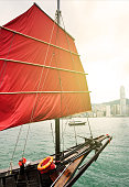 sailboat and Hong Kong harbor