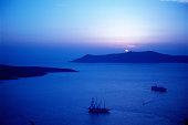 Sailboat and island at sunset