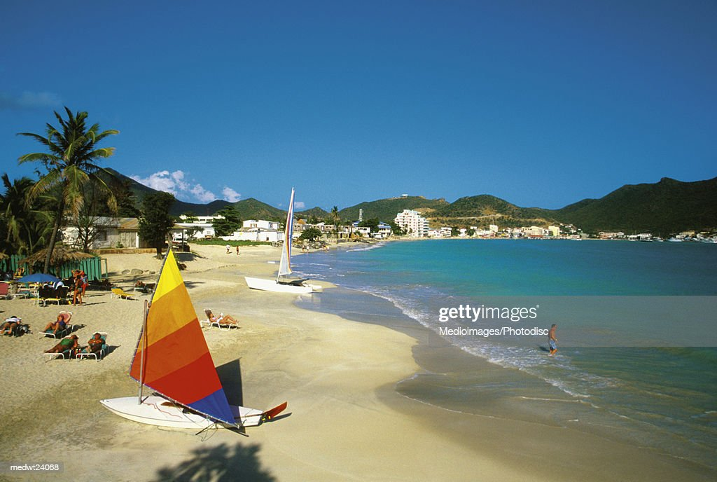 Sailboat and people on Great Bay Beach on Saint Martin, Caribbean