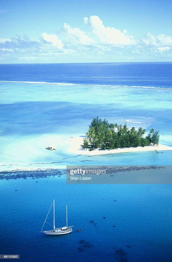 Sailboat and tropical islet
