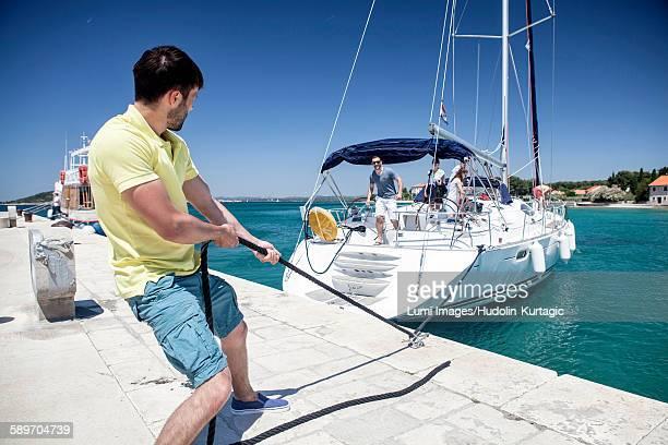 Sailboat arriving harbor, Zlarin, Adriatic Sea