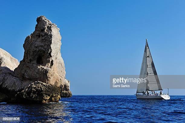 Sailboat by Riou island rocks in the Mediterranean Sea, Marseille, France, Europe