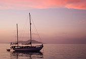 Sailboat in bay at morning