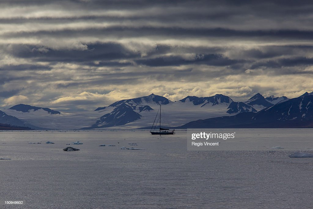 A sailboat in the arctic : Stock Photo