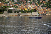 Sailboat in the Villefranche Harbour from a cruise ship in the harbour