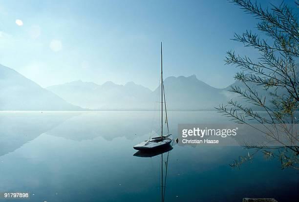Sailboat on calm lake