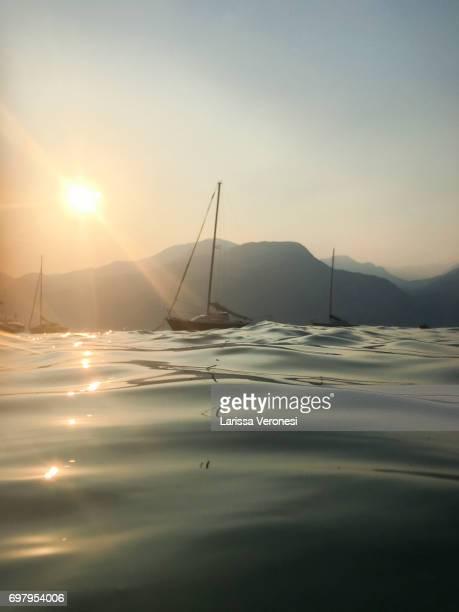 Sailboat on Lake Garda at sunset, Italy