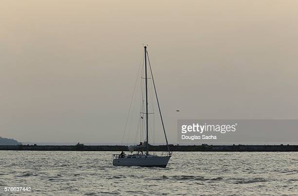 Sailboat on the water on a hazy day