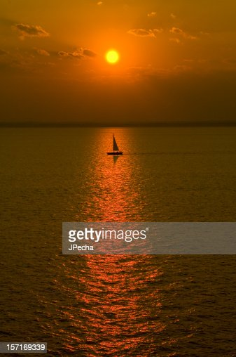Sailboat Out to Sea at Sunset