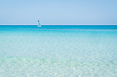 Sailboat sails alone in the Caribbean sea near the coast, wonderful colors  turquoise, blue, azure of the sea.sunny day Varadero Cuba.