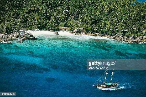Sailboat seen from above La Digue island Seychelles