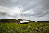 A sailboat stranded in a field by Hurricane Florence in September 2018 in Oriental, North Carolina.