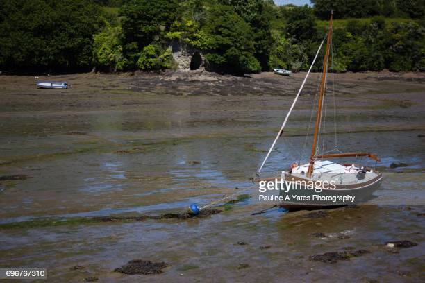 Sailboat stranded on Estuary mudflats during low tide