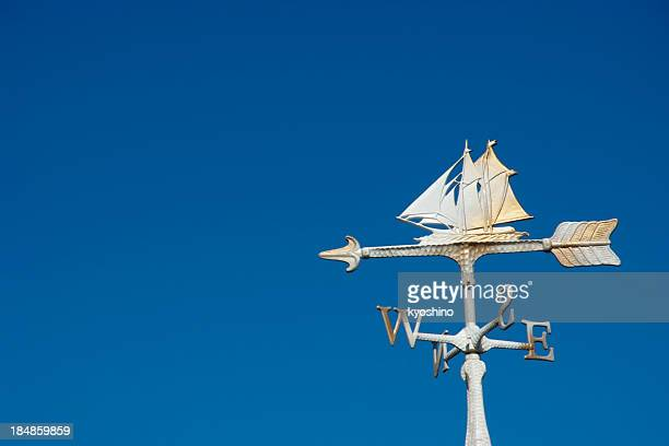 Sailboat wind vane against clear sky with copy space