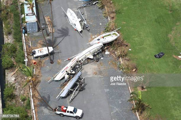 Sailboats are seen capsized on land as people deal with the aftermath of Hurricane Maria on September 25 2017 in San Juan Puerto Rico Maria inflicted...