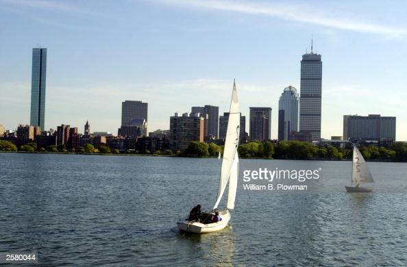 Sailboats are seen on the Charles River with the boston skyline line in the backround October 10 2003 in Boston Massachusetts The Hancock Tower is on...