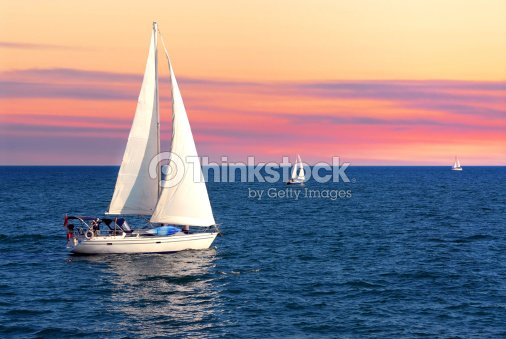 Sailboats at sunset : Stock Photo
