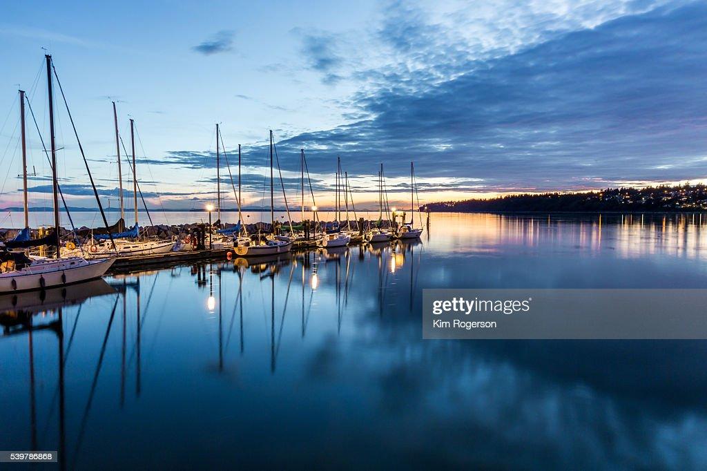 Sailboats docked at dusk in White Rock, BC, Canada