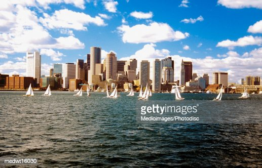 Sailboats in Boston Harbor in front of the financial district of Boston, Massachusetts, USA : Stock Photo