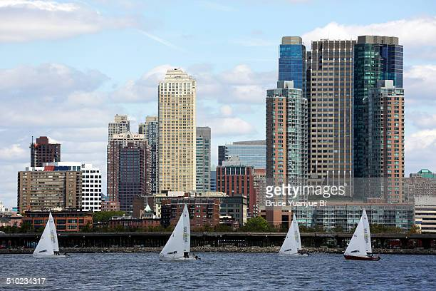 Sailboats in Hudson River with skyline of Manhatta