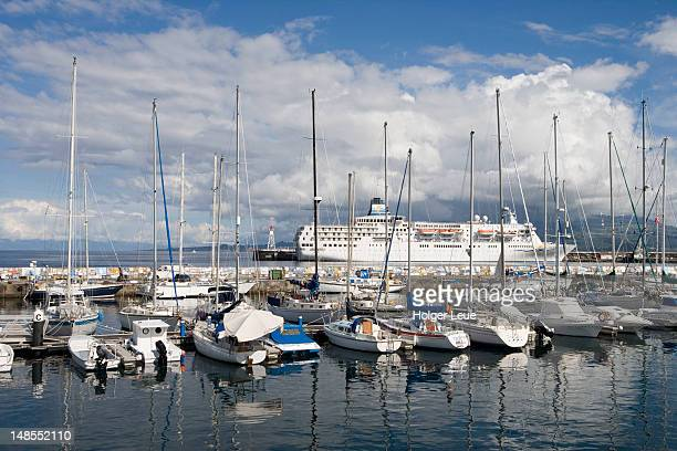 Sailboats in marina and cruiseship Delphin Voyager.