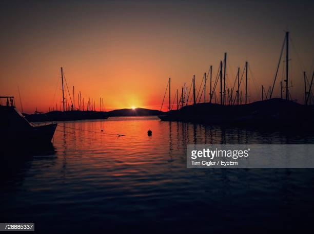 Sailboats In Sea At Sunset