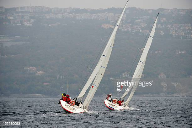 Sailboats leaning during regatta