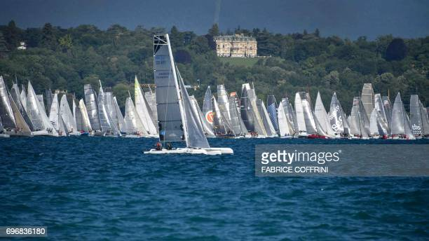 Sailboats line up prior to the start of the 79th edition of the Bol d'Or sailing race on Lake Geneva on June 17 2017 About 550 contestants take part...
