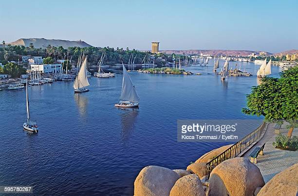 Sailboats Sailing On River Against Clear Sky