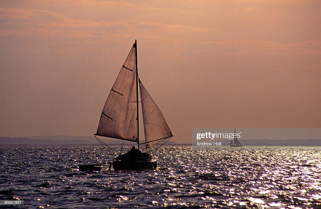 Sailing a sail boat Blakeney, Norfolk  England : Stock Photo