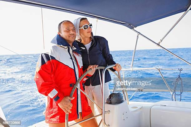 Sailing  Beautiful  couple enjoying in cruising on the  sailing ship