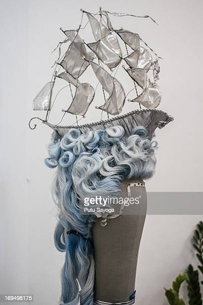 A sailing boat adorns one of the Sari Rambut's wigs in their office on May 21 2013 in Bangli Bali Indonesia Sari Rambut is one of the most well...