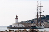 Sailing boat and lighthouse in Ibiza old port