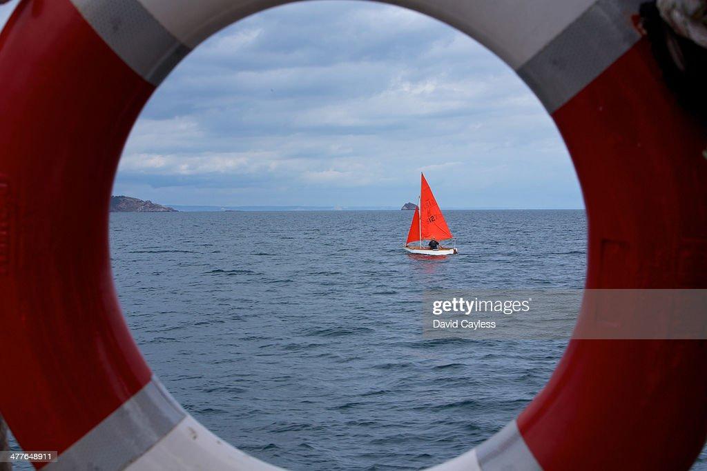 Sailing boat through a life ring