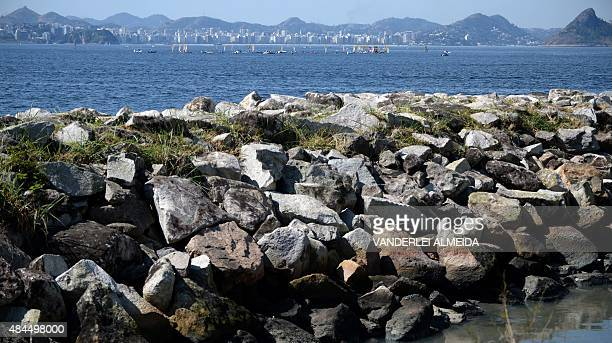 Sailing boats participate in the International Sailing Regatta in the Guanabara Bay in Rio de Janeiro Brazil on August 19 2015 as in the foreground...