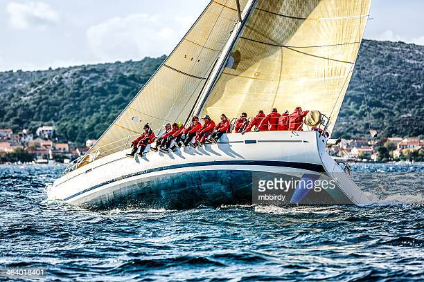Sailing crew on sailboat during regatta