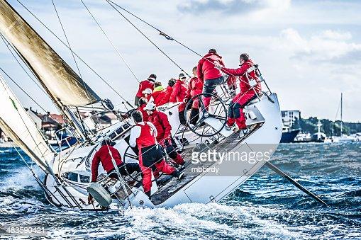 Sailing crew on sailboat during regatta