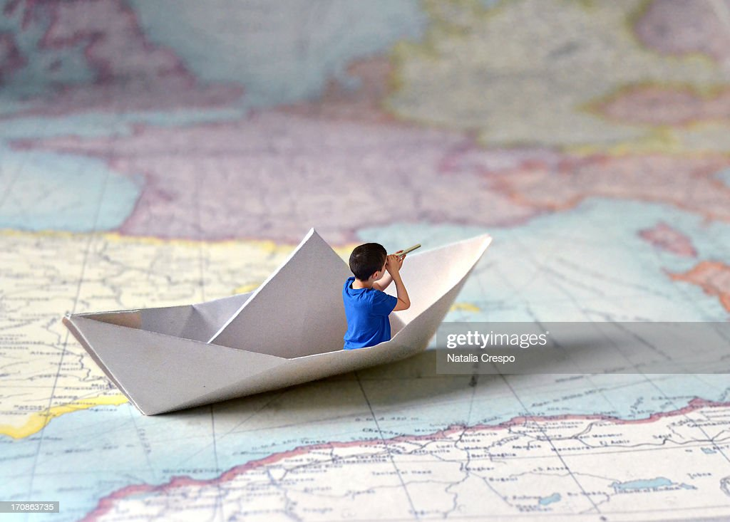 Sailing in a paper ship : Stock Photo