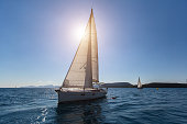 Sailing in the wind through the waves at the Aegean Sea. Luxury yachts.