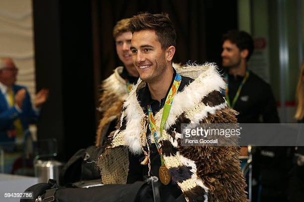 Sailing Olympic Gold medalist Blair Tuke arrives during the New Zealand Olympic Games athlete home coming at Auckland International Airport on August...