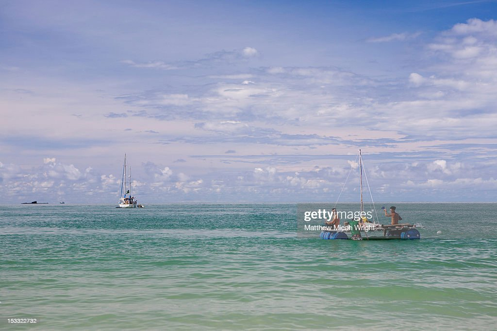 Sailing on a makeshift handmade raft. : Stock Photo
