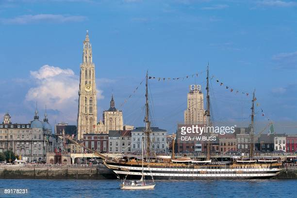 Sailing ship and a boat in a river Schelde River Antwerp Flanders Belgium