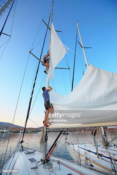Sailing  Team sailors repaired torn sail