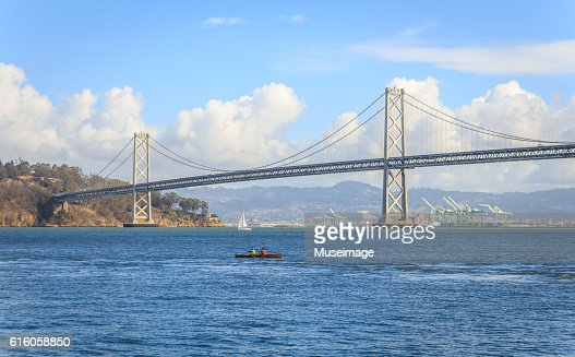 Sailing through the Oakland Bay Bridge Over River Against Sky