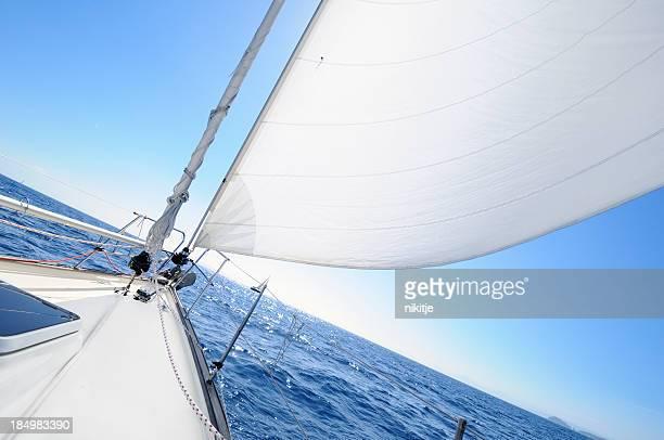 Sailing towards horizon on the sunny day