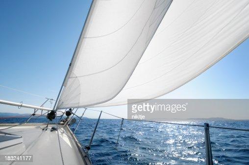 Sailing towards the horizon on a sunny day
