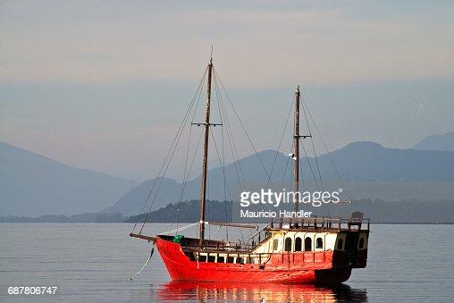 A sailing vessel lies at anchor on Llanquihue Lake, Puerto Varas, Chile.