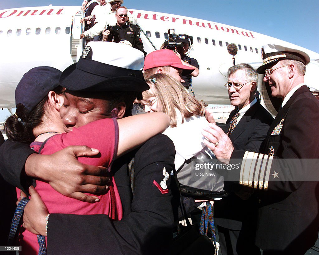 A sailor attached to the guided missile destroyer USS Cole (DDG 67) is greeted by friends and family members upon the crews return to their home port in Norfolk, VA, November 3, 2000. The Honorable Richard Danzig, Secretary of the Navy, Admiral Vern Clark, Chief of Naval Operations and Admiral Robert Natter, Commander and Chief U.S. Atlantic Fleet shook hands with the Sailors and personally welcomed each of them home. (Photo by U.S. Navy/Newsmakers